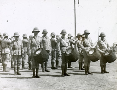 Soldiers on parade with drummers at the front
